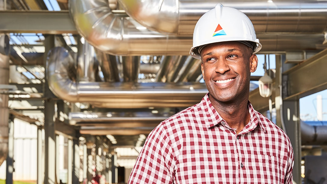 Gas worker smiling FORTUNE magazine world's most admired companies award