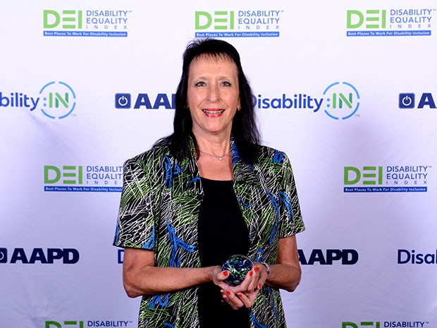 Sam White, senior business analyst for Southern Company Services, accepts Disability Equality Index Award on behalf of Southern Company.