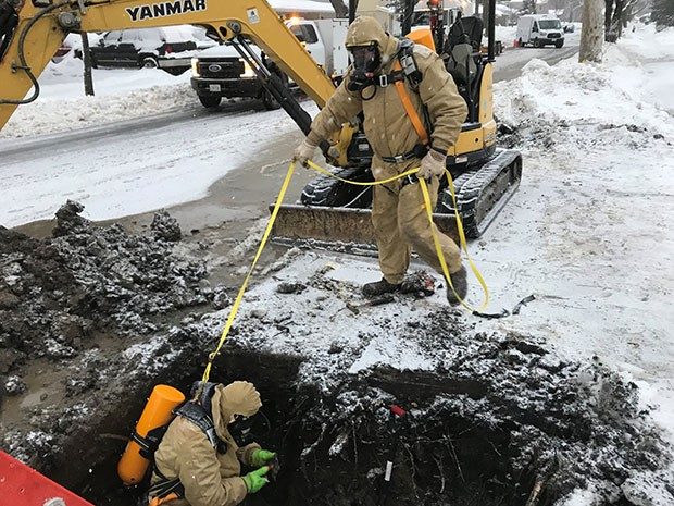 Nicor Gas field operations employees repair a leaking natural gas service line.