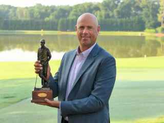 Stewart Cink poses with the Payne Stewart Award.  Photo credit - Stan Badz / PGA TOUR