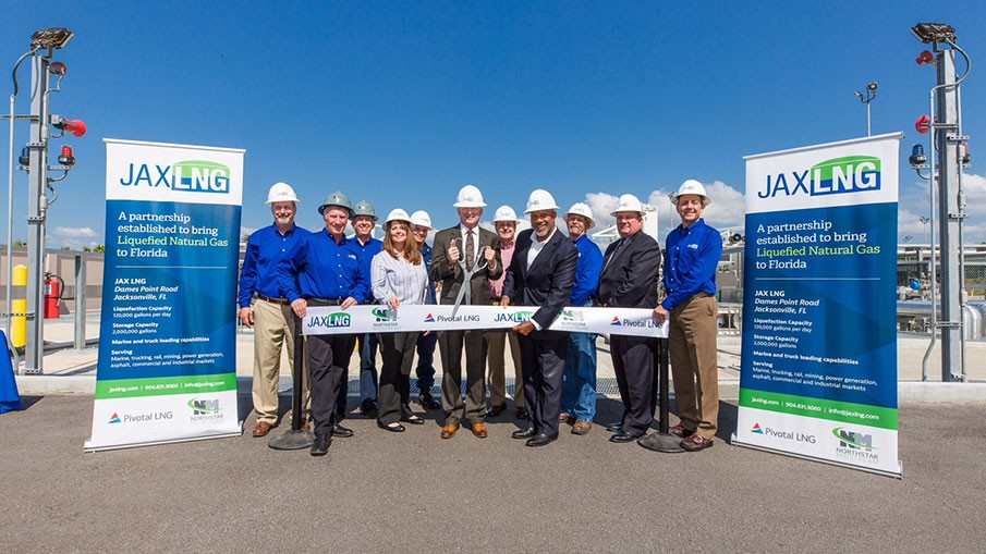 Executives and LNG plant workers attend the ribbon cutting ceremony
