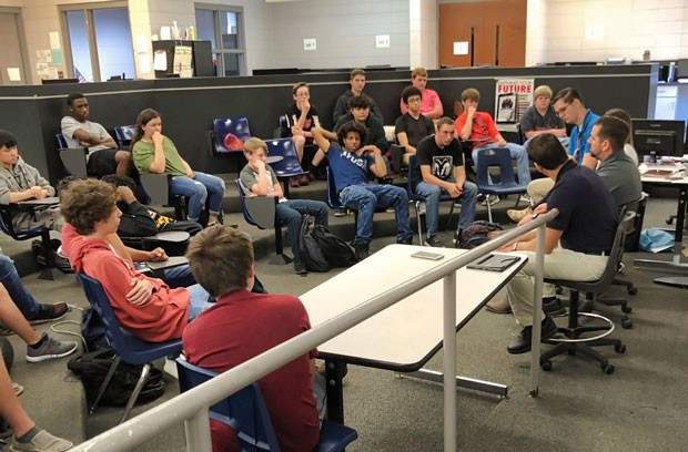 A group of Appling County High School students listen to Plant Hatch engineers share their career experiences.