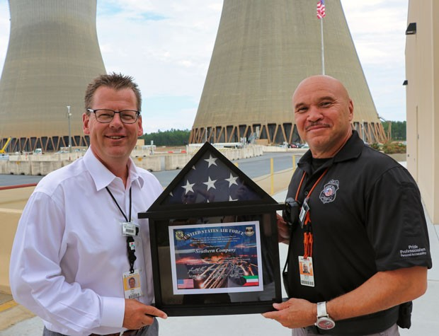 Vogtle 1&2 Site Vice President Darin Myers accepted the framed flag and certificate that Senior Nuclear Security Officer Wayne Scott
